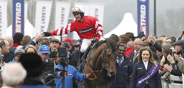 13.03.2015 - Cheltenham; Winners presentation with Nico de Boinville after winning the Betfred Cheltenham Gold Cup Chase Grade 1 with Coneygree. Credit: Lajos-Eric Balogh/turfstock.com