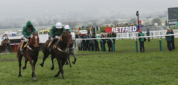 13.03.2015 - Cheltenham; Peace And Co  ridden by Barry Geraghty (green cap) wins the JCB Triumph Hurdle Grade 1. Second place: Top Notch ridden by Daryl Jacob. Credit: Lajos-Eric Balogh/turfstock.com