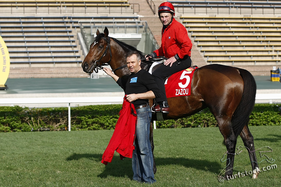 07. Dec. 2011 - Sha Tin Racecourse; Trainer Waldemar Hickst and Zazou during the morning track work at Sha Tin Racecourse. Credit: Lajos-Eric Balogh/turfstock.com
