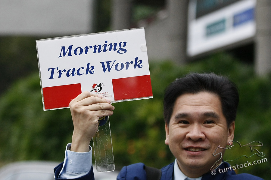 09. Dec. 2011 - Sha Tin Racecourse; Impressions; Man shows the way to the moning track work. Credit: Lajos-Eric Balogh/turfstock.com