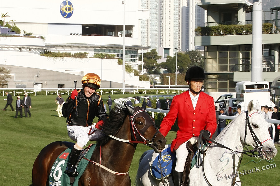 11. Dec. 2011 - Hongkong - Sha Tin Racecourse; Winners presentation with Able One, ridden by Jeff Lloyd after winning the Cathay Pacific Hong Kong Mile - Group 1 (Turf). Credit: Lajos-Eric Balogh/turfstock.com