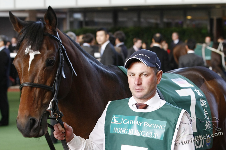 11. Dec. 2011 - Sha Tin Racecourse; Zazou and groom Radek Henning in the parade ring before the Cathay Pacific Hong Kong Cup - Group 1 (Turf). Credit: Lajos-Eric Balogh/turfstock.com