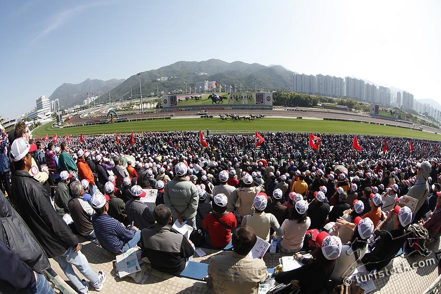 11. Dec. 2011 - Sha Tin Racecourse; Impressions: Racegoers enjoy the races at Sha Tin Racecourse in front of the skyscrapers. Credit: Lajos-Eric Balogh/turfstock.com
