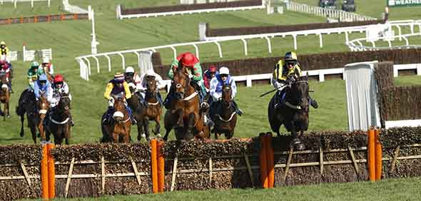 15.03.2017 - Cheltenham; Willoughby Court ridden by Davids Bass (yellow-black silks) wins the Neptune Investment Management Novices Hurdle (Registered As Baring Bingham Novices Hurdle) Grade 1 at Cheltenham-Racecourse/Great Britain. Second place: Neon Wolf ridden by Noel Fehily (green-red silks). Credit: Lajos-Eric Balogh/turfstock.com
