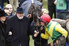 17.03.2017 - Cheltenham; Winners presentation with Ann and Alan Potts. Jockey Robbie Power kissing Sizing John after winning the Timico Cheltenham Gold Cup Chase (Grade 1) at Cheltenham-Racecourse/Great Britain. Credit: Lajos-Eric Balogh/turfstock.com