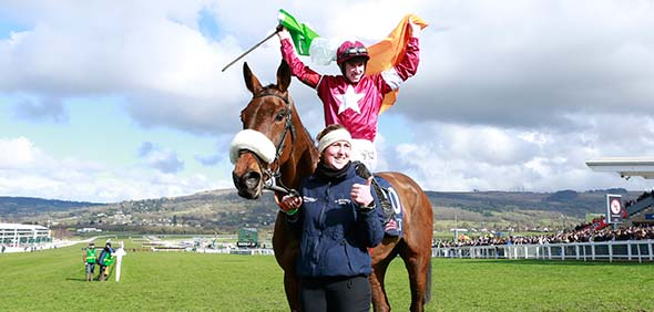 15.03.2018 - Cheltenham; Winners presentation with a irish flag holding jockey Jack Kennedy after winning the JLT Novices Chase (Registered As The Golden Miller Novices Chase) Grade 1 with Shattered Love at Cheltenham-Racecourse/Great Britain. Credit: Lajos-Eric Balogh/turfstock.com